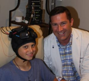 Student Receiving Transcranial and Magnetic Stimulation and Neurofeedback Traning at the NeuroEdge Brain Performance Center Connecticut